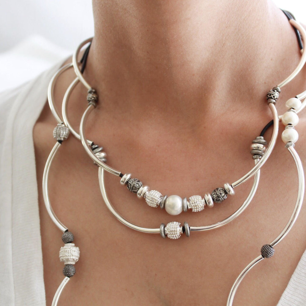 The  Kristy  worn as a necklace paired with  Emily Long .