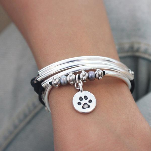 The  Charmer with round paw charm  has room for addition charms of your choice.