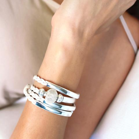The  Mini Maddie  braided wrap bracelet is shown in metallic pearl leather.