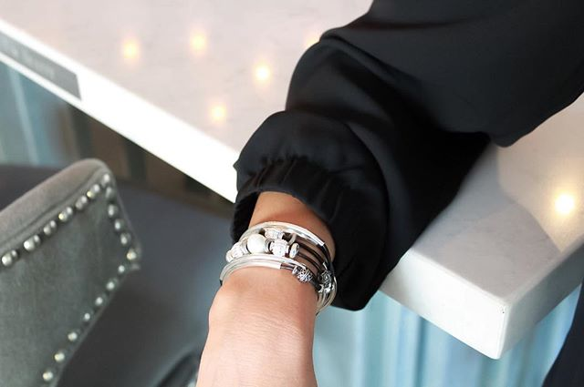 The  Kristy  wrap bracelet adds an elegant touch with its freshwater pearl.