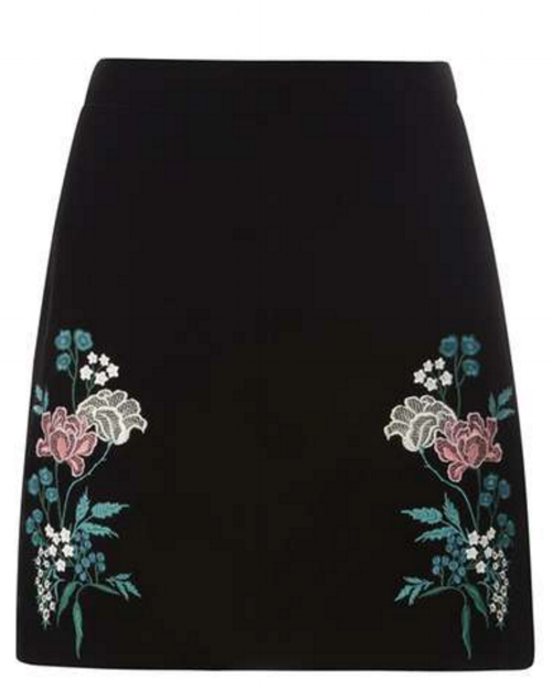 Pearls look amazing with this  black embroidered velvet skirt .