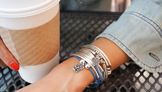 Really boost someone's day by buying them a cup of coffee. This  Girlfriend wrap  is shown with added  Flower Rectangle Charm  and stacked with  Mini Love with Druzy Charm .
