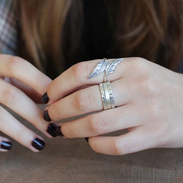 The  Feather Sterling Silver  ring stacked with  Hammered Sterling Silver Rings  and the  Satin Sterling Silver Ring .