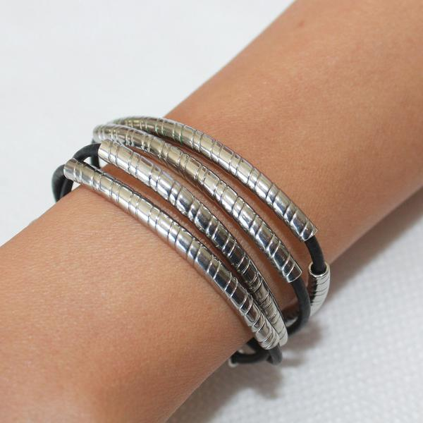 The  Lasso  wrap bracelet features stunning stainless steel crescents.