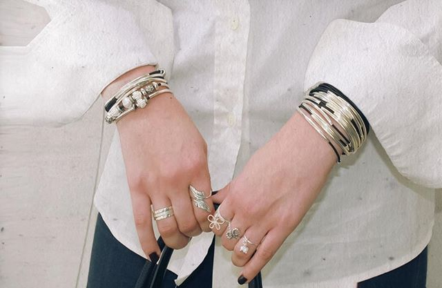 The  Kristy  and  Lizzy Classic  wrap bracelet paired with many rings from the  Sterling Silver Ring Collection .