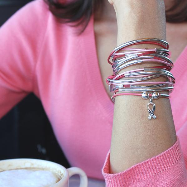 The  Girlfriend wrap with Hope Ribbon Charm  layered perfectly with the  Lizzy Too Pink 5 Strand.