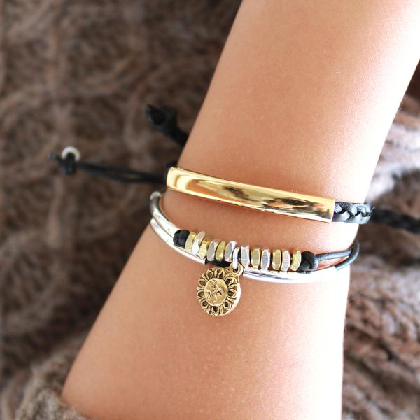 the  Stacked Joy Bracelet Set with Gratitude and Wink Bracelets .