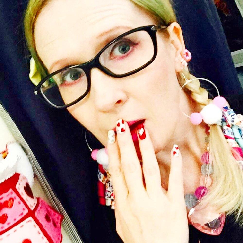 @trishykitty wearing her pom pom hoops and doughnut studs