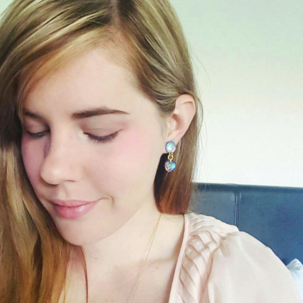 @eriinator showing off her mermaid love earrings