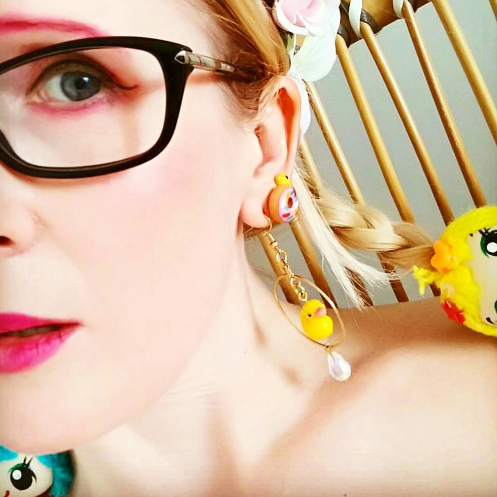 Trendsetter @trishykitty accessorising with fun hair ties, and our rubber duckie dangle hoops and doughnut studs