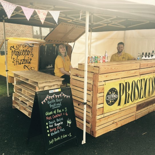 The sun is shining and the fizz is flowing...Fizzbuz is all set up at the  #beithfest and our staff are serving with a smile 😬 Pop along for not only some of our amazing fizz but treat yourself to one of our delicious @theginbothy gins. We are here till 9pm #fizzbuz #prosecco #ginbothy #ginandproseccococktails #beithfest