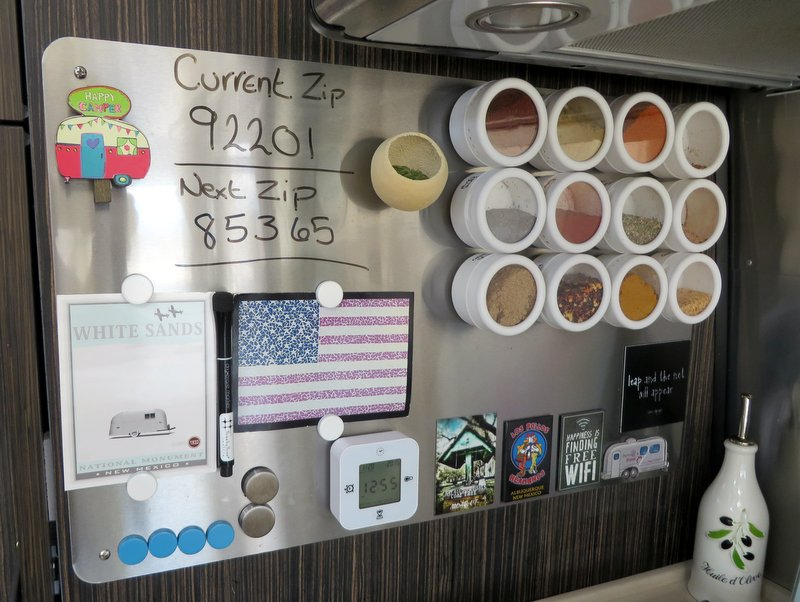 We added a magnetic board for spices and to keep the wall clean beside the stove top.