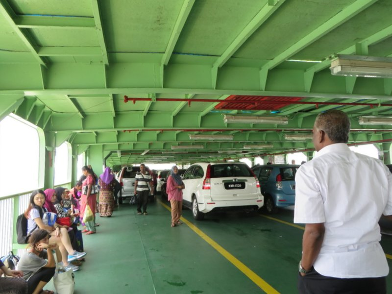Standing room only on the open car deck during the short ferry crossing.