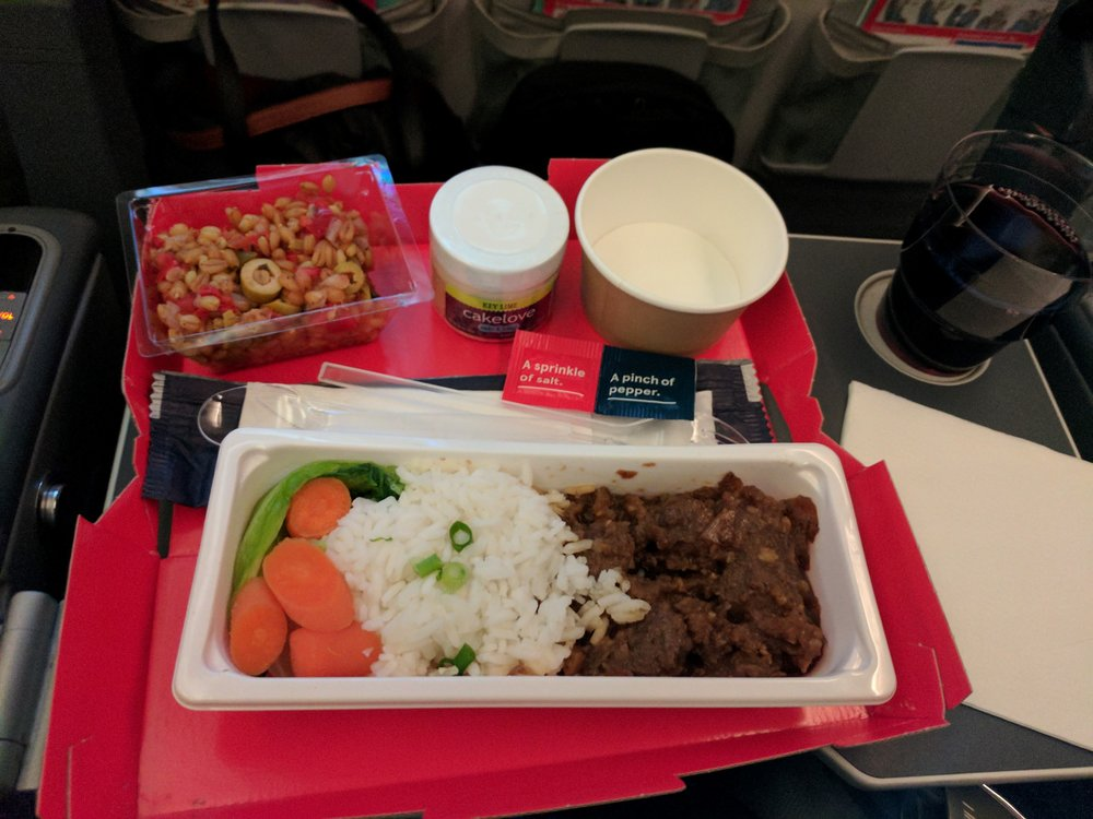 Included in our LowFare+. 3 courses and a glass of wine. Food was just meh, pretty typical of most coach-level airline offerings