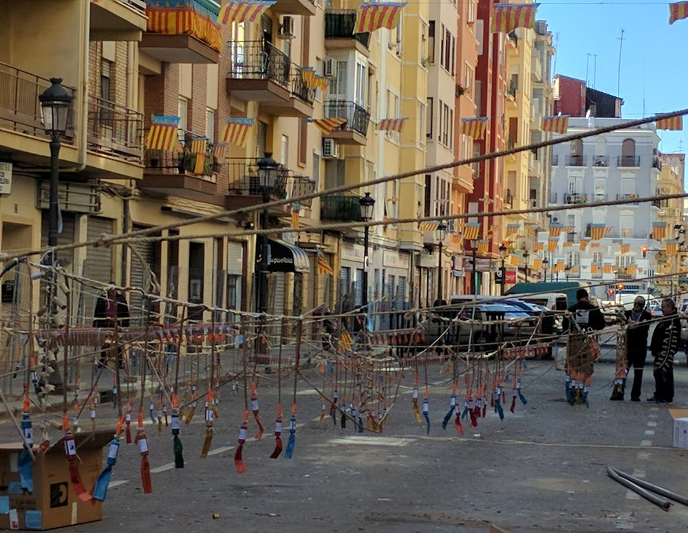 Each block organizes its own set of firecrackers that thunder throughout the city at various times of day