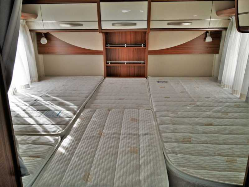 Large twin beds in the rear give maximum storage but still allow sleeping longitudinally.