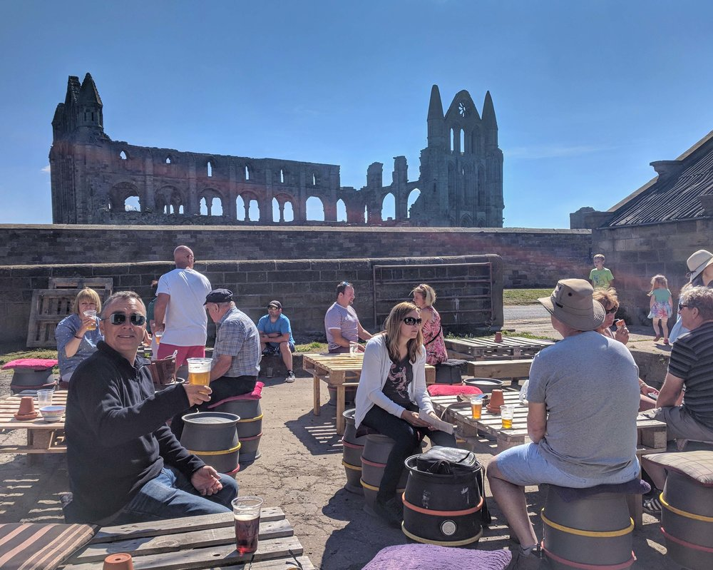 Drinking local beer at a brewery in the shadow of the abbey.