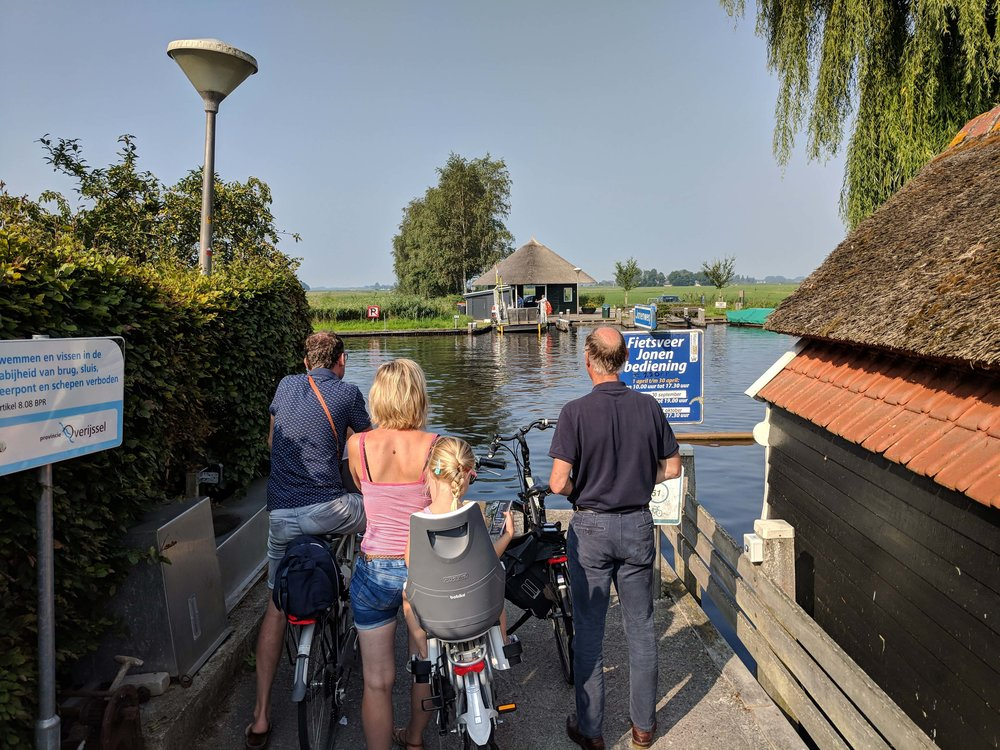 Along with our fellow passengers, we surprisingly find a boat on our cycle path
