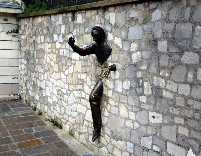 jean-marais-sculpture-le-passe-muraille-paris-france-dec-man-who-walked-walls-montmartre-title-80057725.jpg