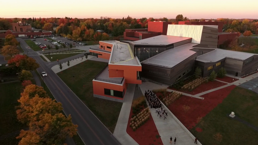 Mid-way through lift-off the drone cam captures the new Performing Arts Center in Potsdam along with- oops bottom right- the crew!