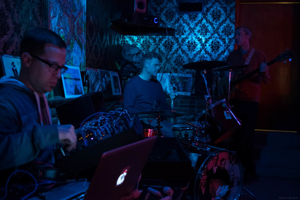 Playing at The Buccaneer Lounge in December with Jerod Sommerfeldt (left) and Stephen Bird (right)  We improvise electronics, drums, and bass.  Album coming in the Spring, I believe.