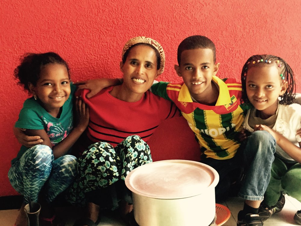 Carolyn Usher, a longtime sponsor of the group home, took this photo of her daughter Lilly, group home mom Mulu, her sponsored child Yabi, and Lilly's sister Mekdi (left to right).