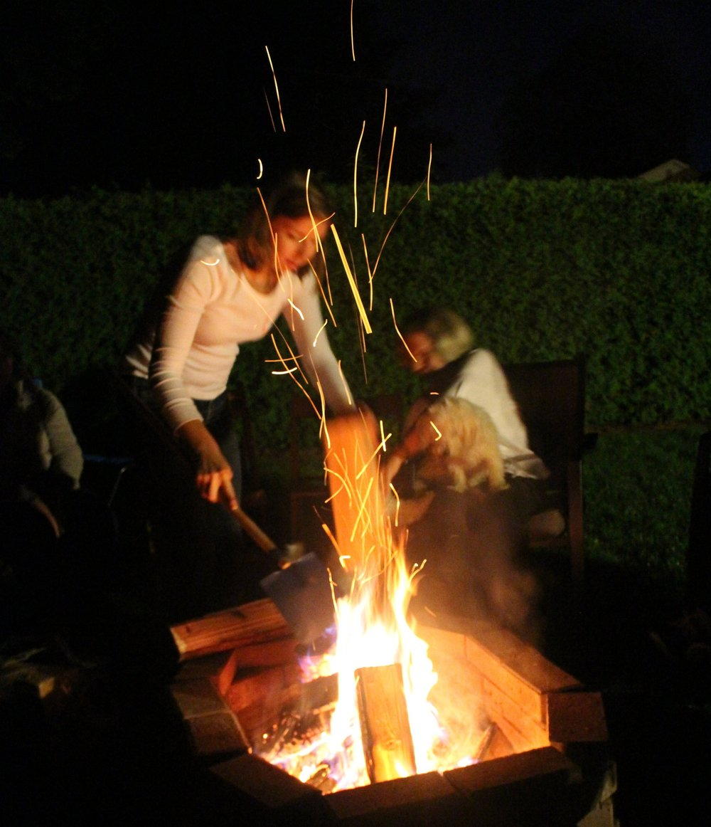 Brittany tends the fire at the Volunteer Appreciation event in September 2016.