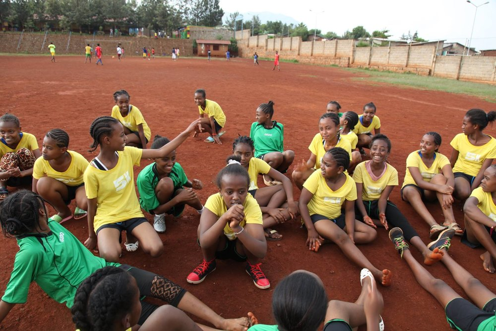 Girls get ready to stretch out after practice in Sodo, Ethiopia.