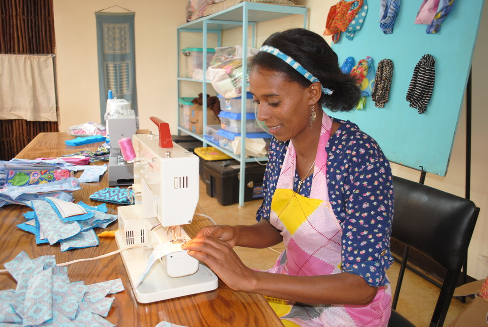 Serkalem hard at work making washable, reusable, affordable pads (WRAPS) at the Wolaitta Village facility.