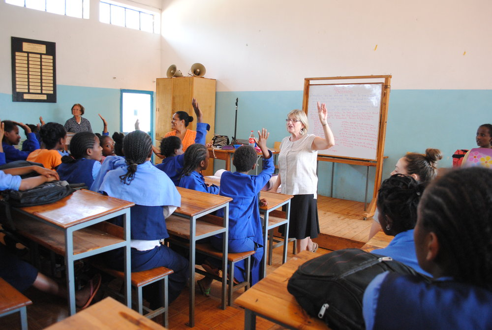 Allison teaches a workshop on WRAPS at Abba Pascal Girls School, one of the sites for Girls Gotta Run programming.