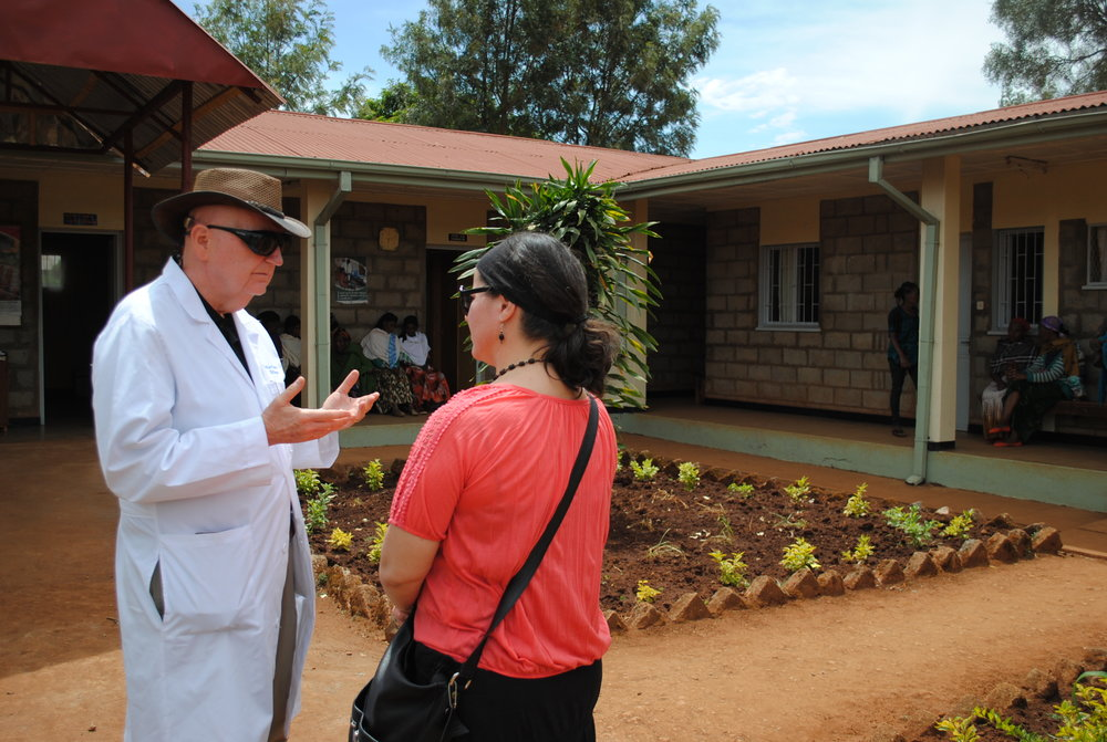 Dr. Mark chats with Shelley outside the Bucama Health Clinic in rural Ethiopia in February 2017. This facility directs some patients to Soddo Christian Hospital to undergo surgery with Dr. Mark.