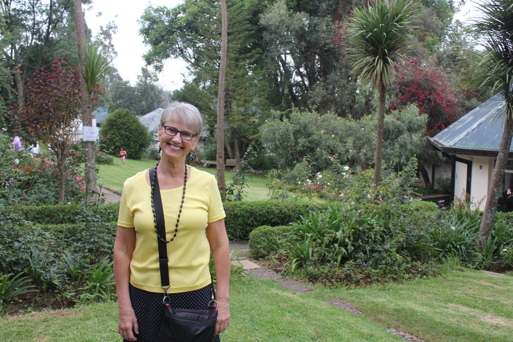 Val takes in the beautiful gardens on the grounds.