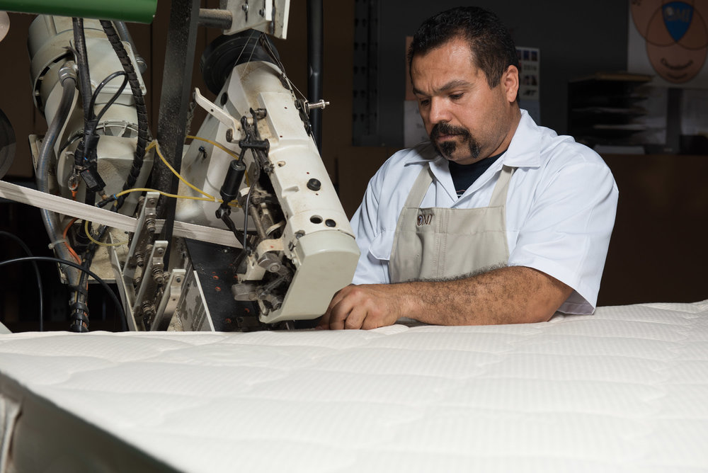 Organic mattress being sewn together