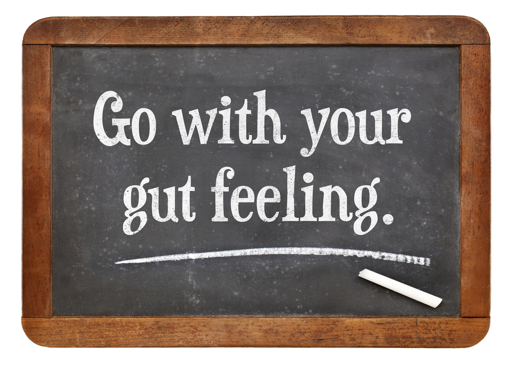 go with your gut feeling - advice or motivational reminder on a vintage slate blackboard