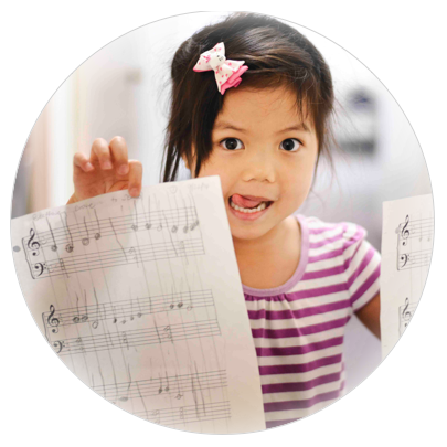 Maya (age 5) proudly shows off her composition after her Saturday Harmony Road III class.