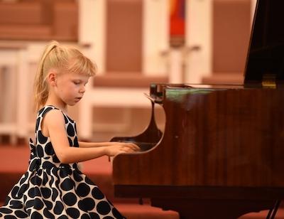 Ella plays at the New Mozart Summer Recital in June 2018