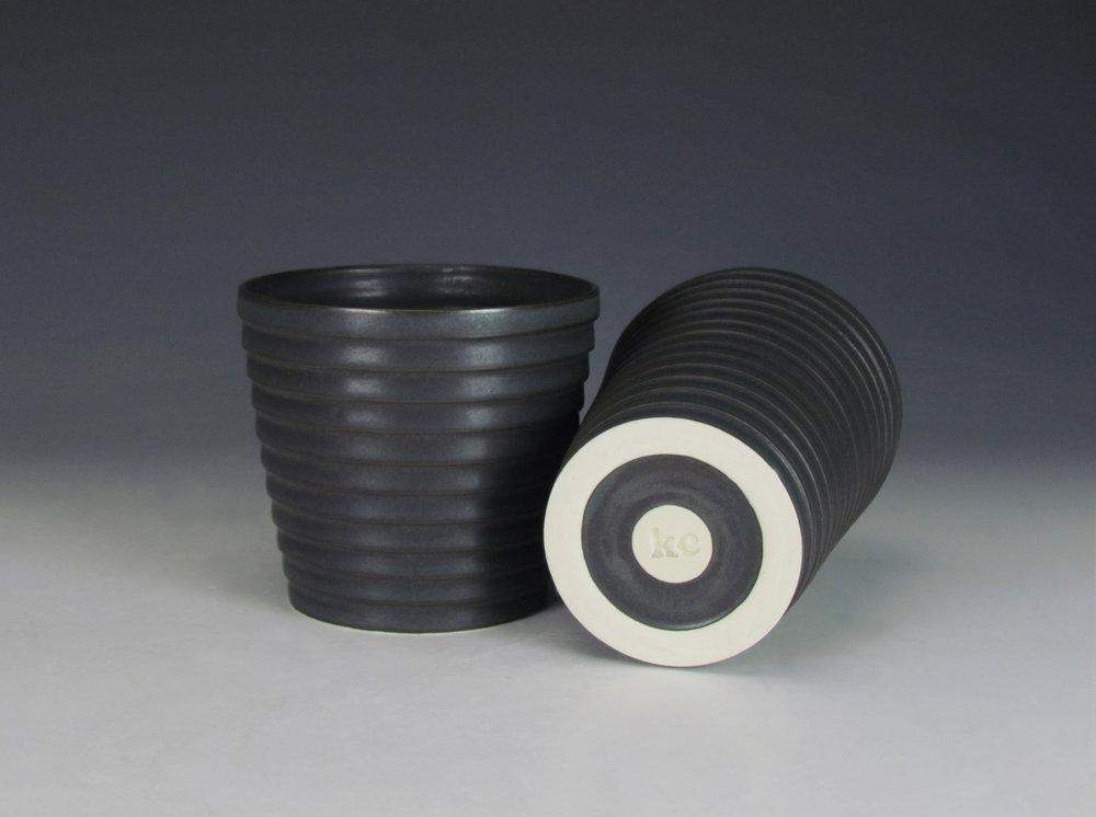 Tumblers (Black)  |  Each: 6 x 4 x 4 inches  |  Porcelain, Glaze  |  2016