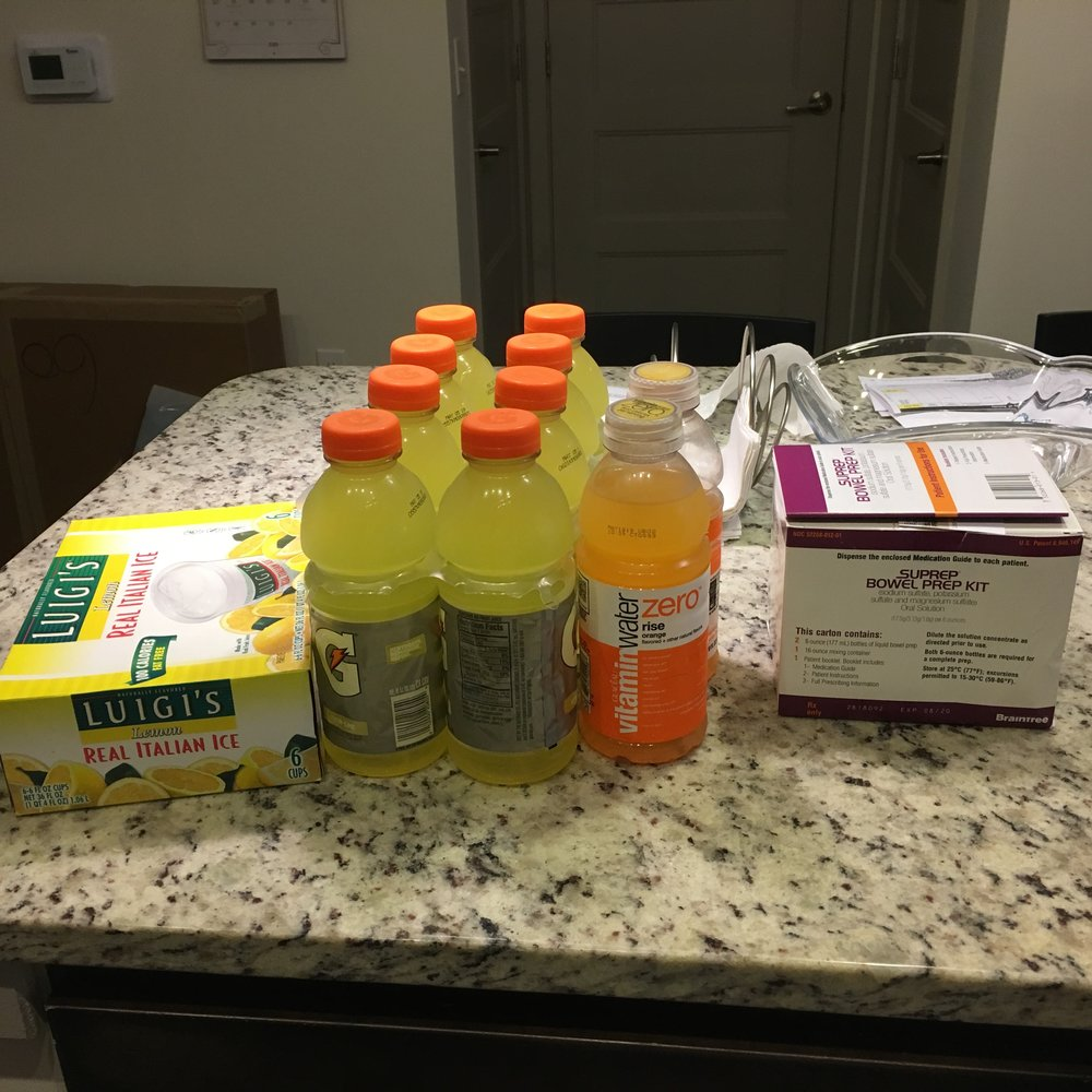 Getting ready for a colonoscopy with Italian ice, Gatorade, Vitamin Water, and Suprep Bowel Prep Kit.