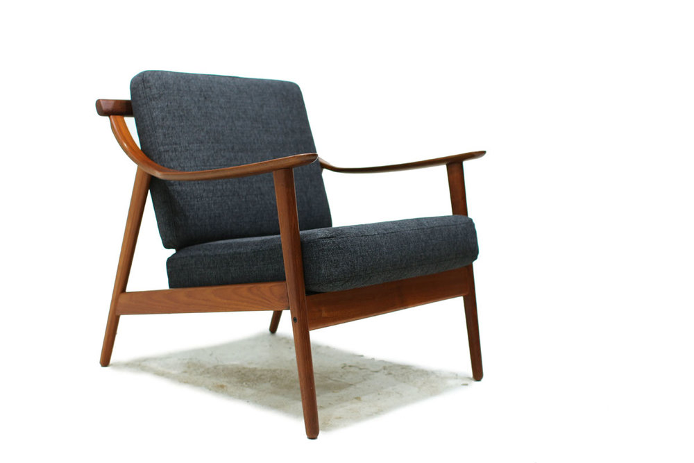 1960's Danish Designer Teak Wood Lounge Chair With Sculpted Armrests and Dark Gray Cushions Designed by Arne Hovmand Olsen