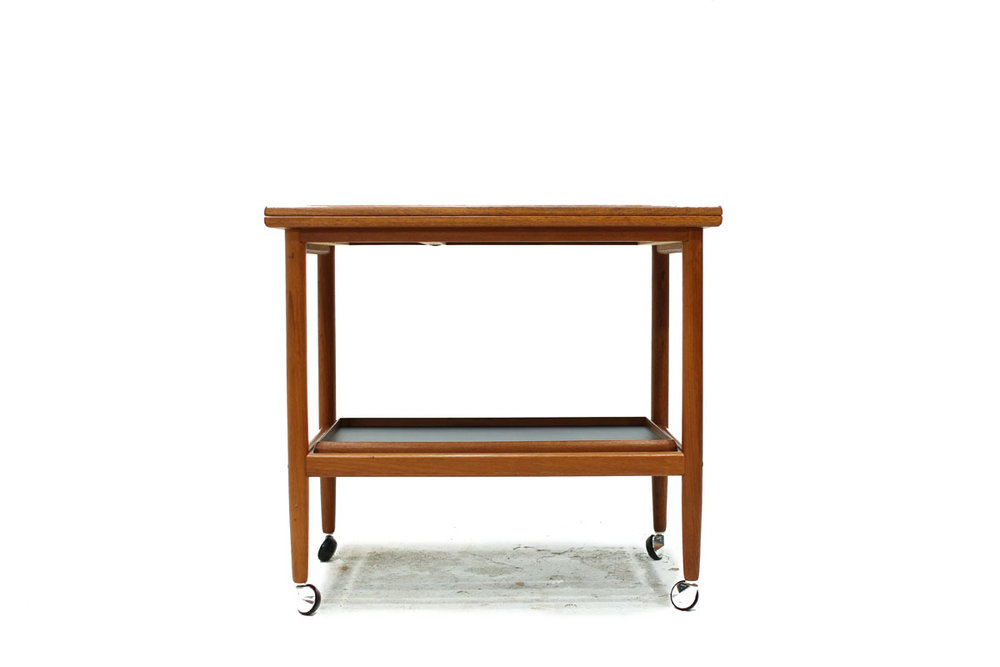 Danish Mid Century Modern Rolling Teak Wood Serving Bar Cart with Expandable Top by Designer Grete Jalk