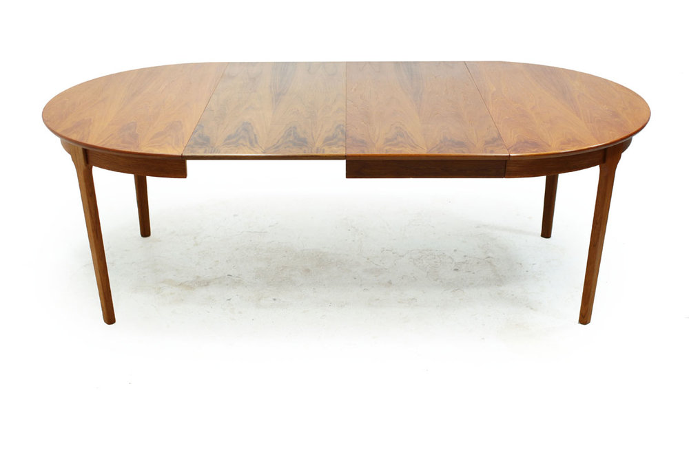 Mid Century Modern Round Extendable to Oval Teakwood Table with 2 leafs and notched leg system