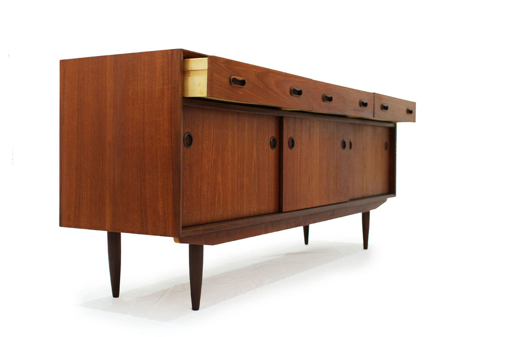 1960's Mid Century Modern 3 Door 3 Drawer Teak wood Credenza / Sideboard with Circle Handles and lots of storage