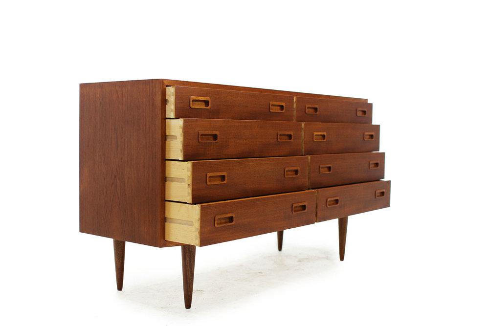 http://www.furniture1950.com/teak-8-drawer-dresser-by-poul-hundevad-item-0339