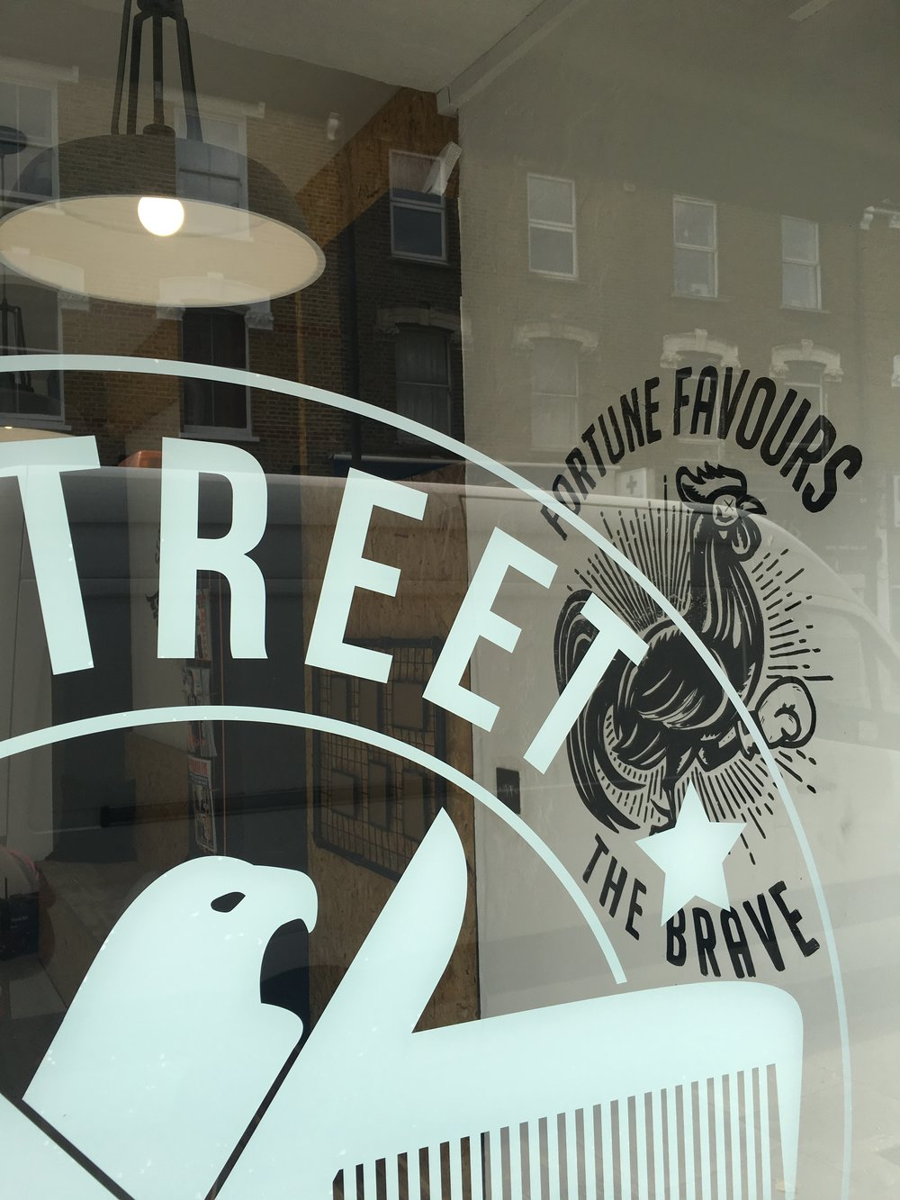 window logo at e-street barbers hackney