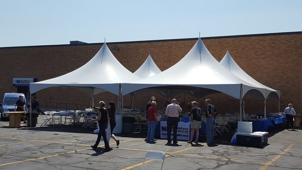 A 40x40 frame tent on cement for a corporate event.