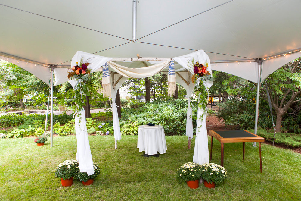 Wedding chuppah under our 20x40 tent with lights