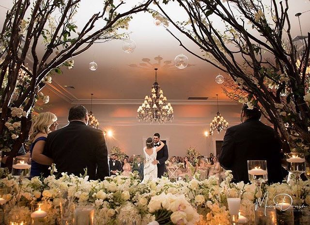 Love this view of our bride & groom from their seats at the sweetheart table! You can even see the expressions of loving family & friends. Thank you for capturing @manolodoreste! We loved working with @the_event_studio on this stunning @thebathclub wedding! #eventdesign #floraldesign #flowers #miamiweddings #centerpiece #miamibeach #beautyandthebasto #petalproductions