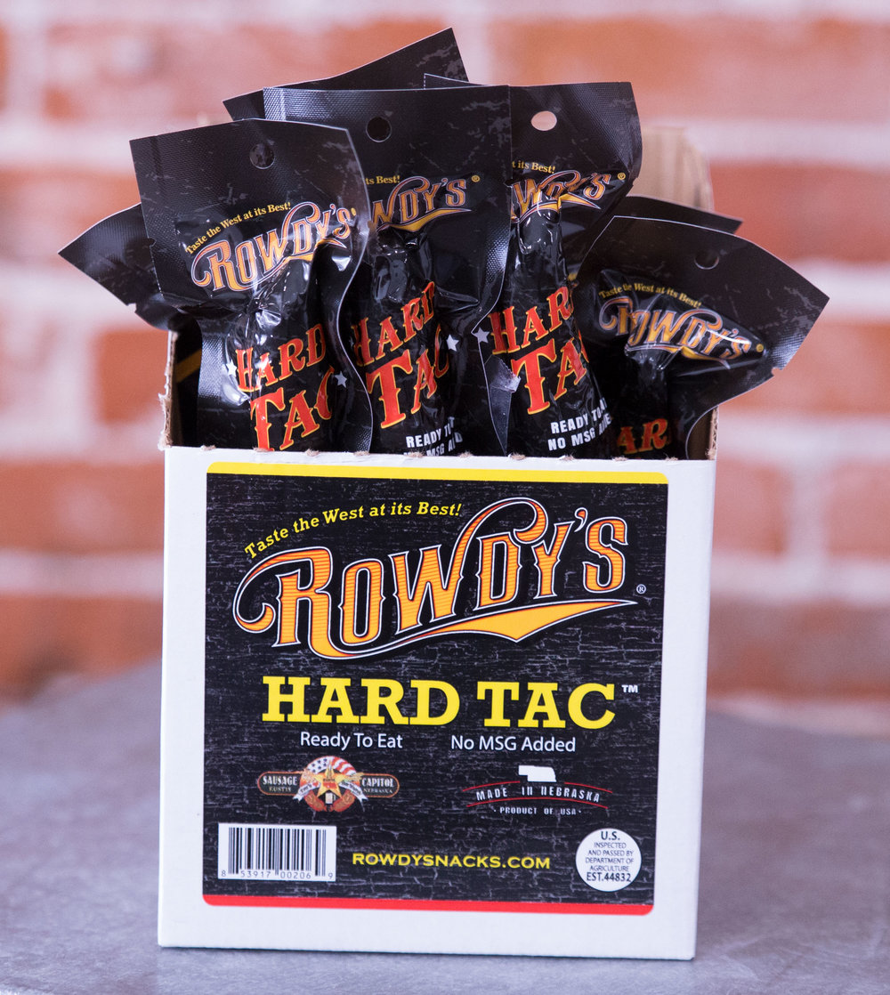 "Rowdy's Hard Tac  –   It's not jerky and it's not a beef stick… it's ""Hard Tac""!  A smoky flavored, dry-cured ""eat on the go"" sausage snack like nothing you've ever experienced!     $2.89 / stick (1.5 oz)        $49.32 / box of 18   $187.42 / case of 72"
