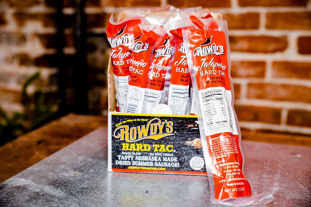 """Rowdy's Jalapeño Hard Tac    – It's not jerky and it's not a beef stick… it's """"Hard Tac""""! Same great recipe as the original Hard Tac with just enough heat to make you want more!    $2.89 / stick (1.5 oz)    $49.32 / box of 18   $187.42 / case of 72"""