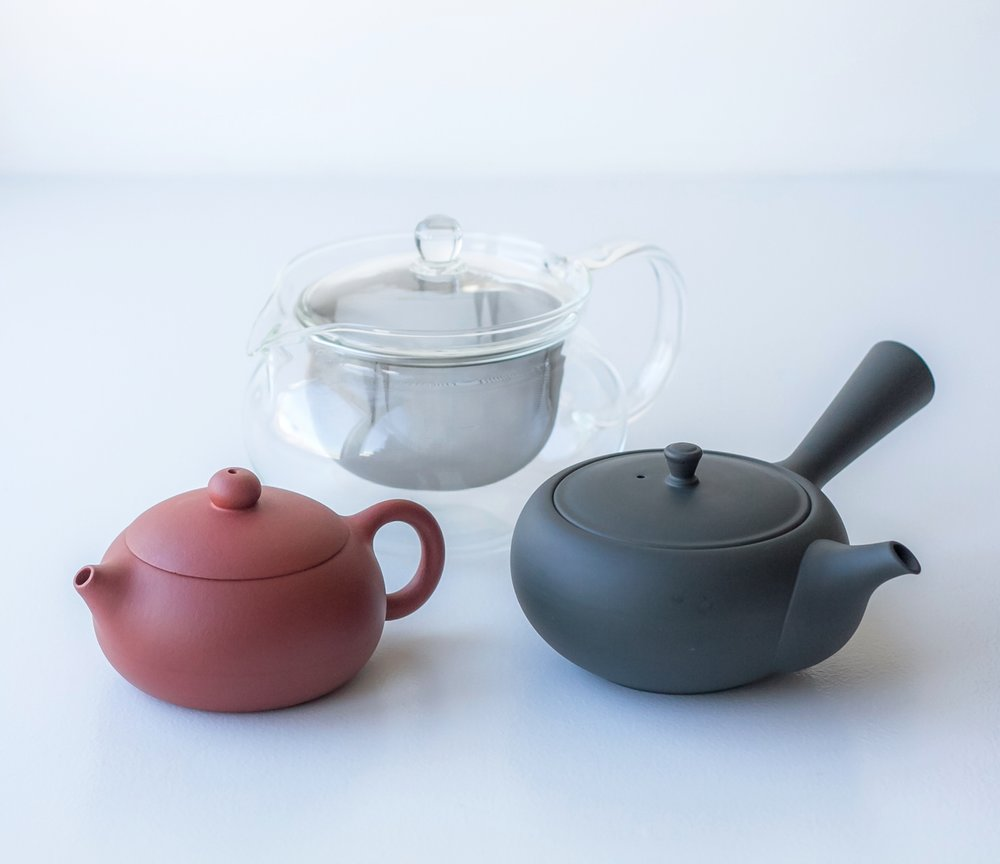 My beloved tea pots: small yixing tea pot (left), Western style glass tea pot (center) and Japanese kyusu (right).